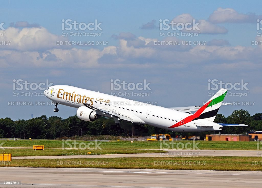 Emirates Boeing 777-300 taking off from Manchester Airport. stock photo