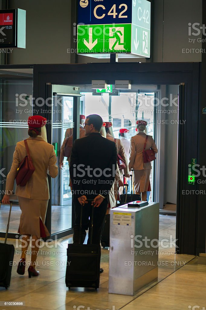Emirates cabin crew on way to airbridge and A380 stock photo
