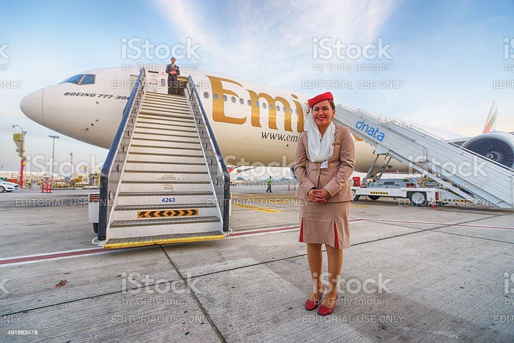 Emirates crew member near aircraft stock photo