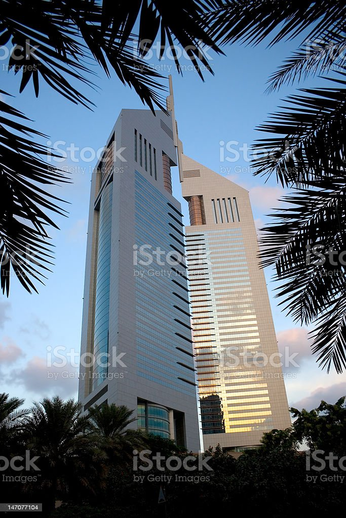 Emirates Towers with palm tree frames stock photo