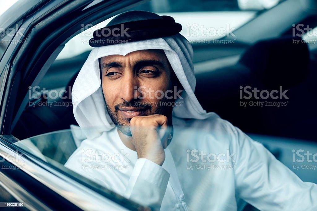 Emirati Businessman in a car, Dubai stock photo