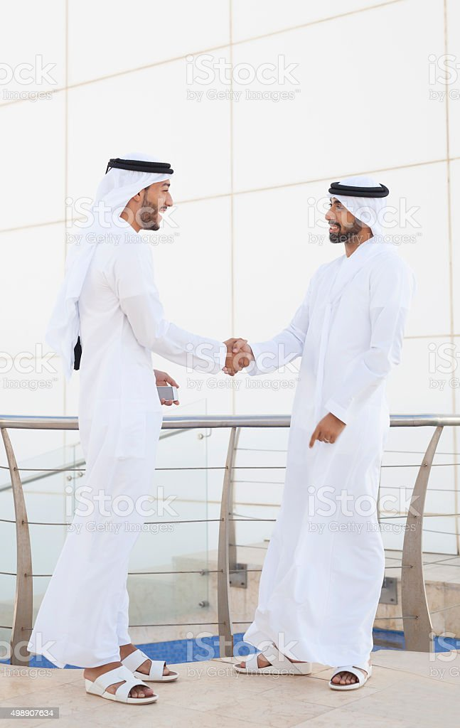 Emirati Businessman Thrilled To Meet New Colleague stock photo