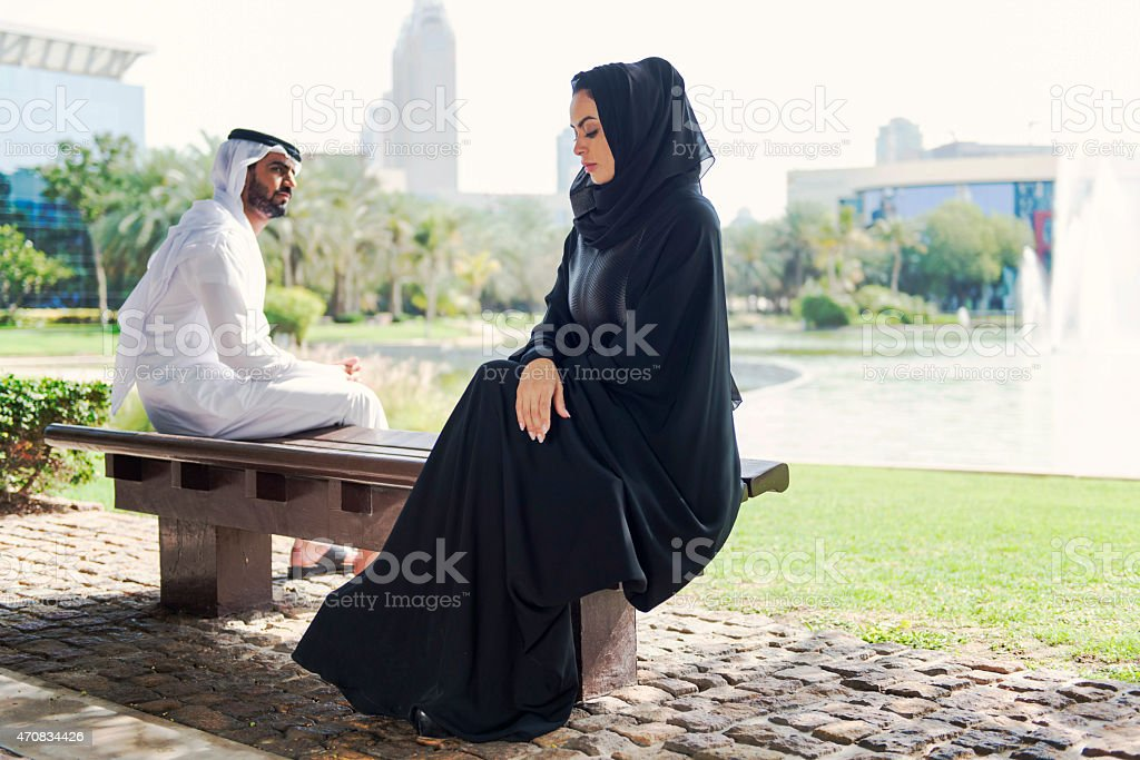 Emirati couple in the park stock photo