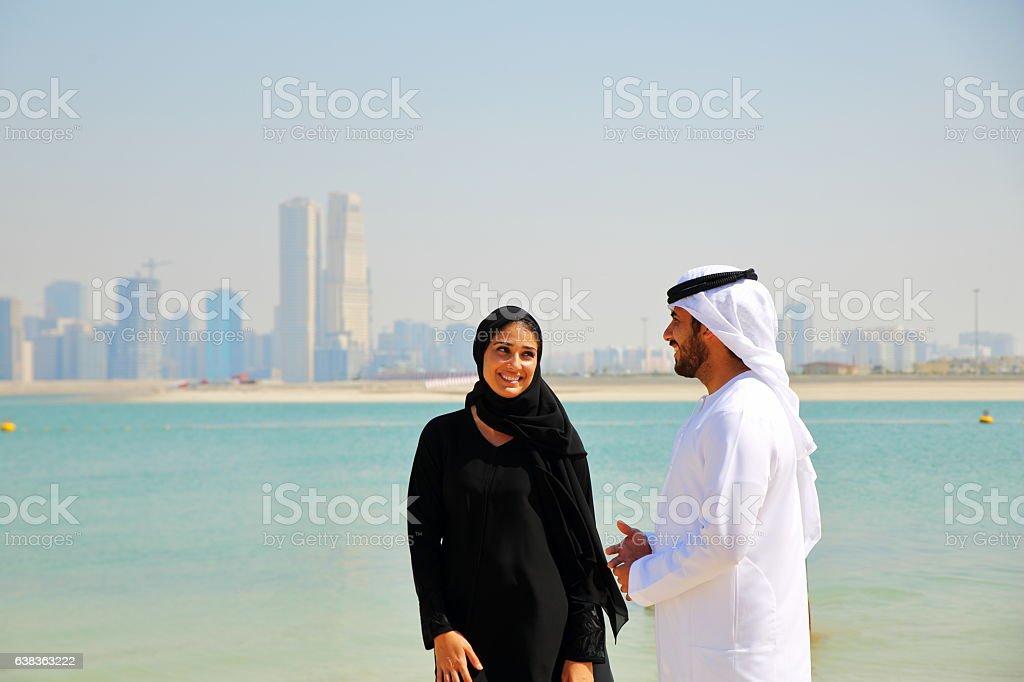 Emirati couple talking stock photo