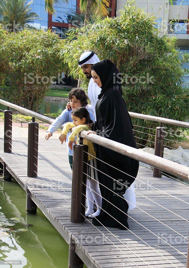 Emirati family enjoying time in the park, Dubai, UAE stock photo