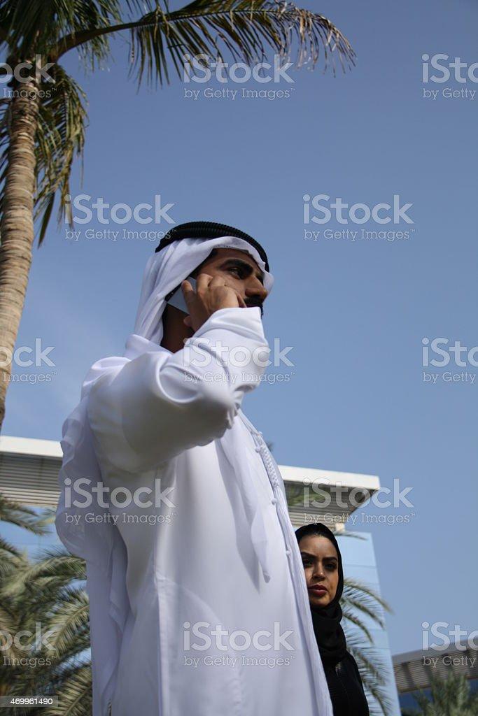 Emirati man and woman in traditional dress, Dubai, UAE stock photo