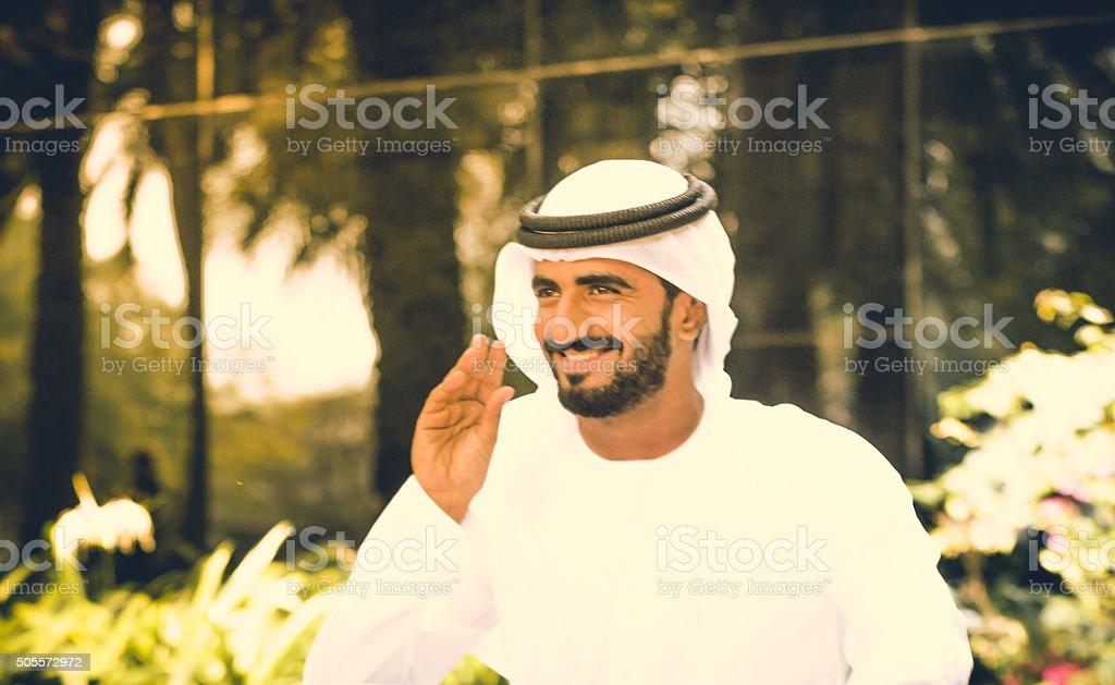 Emirati Man in a park stock photo