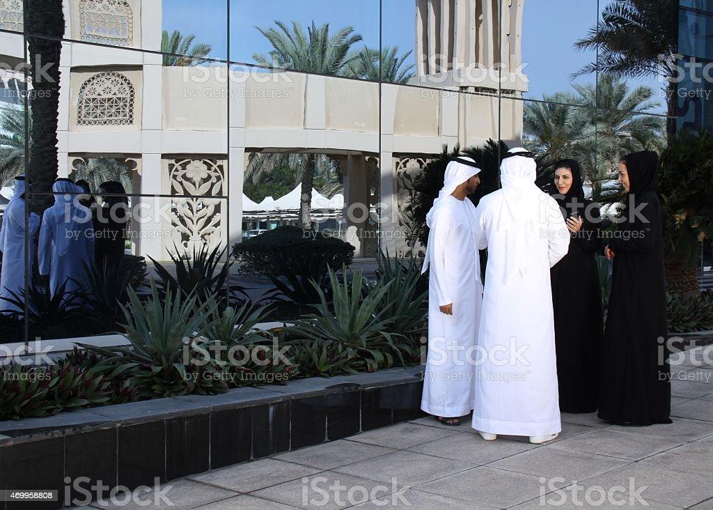 Emirati men and women having a discussion, Dubai UAE stock photo