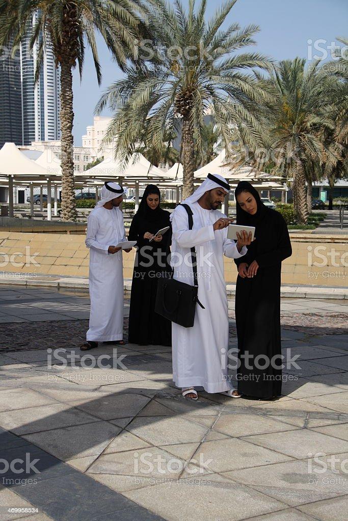 Emirati men and womenhaving a discussion, Dubai UAE stock photo