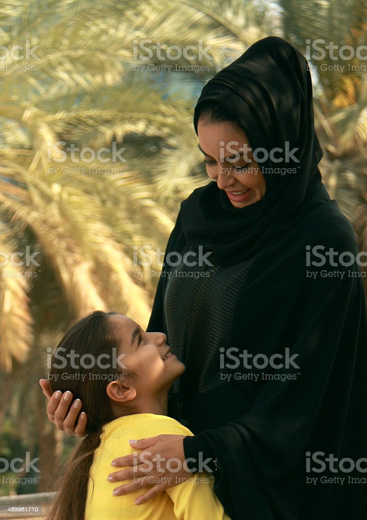Emirati mother and daughter in traditional dress, Dubai, UAE stock photo