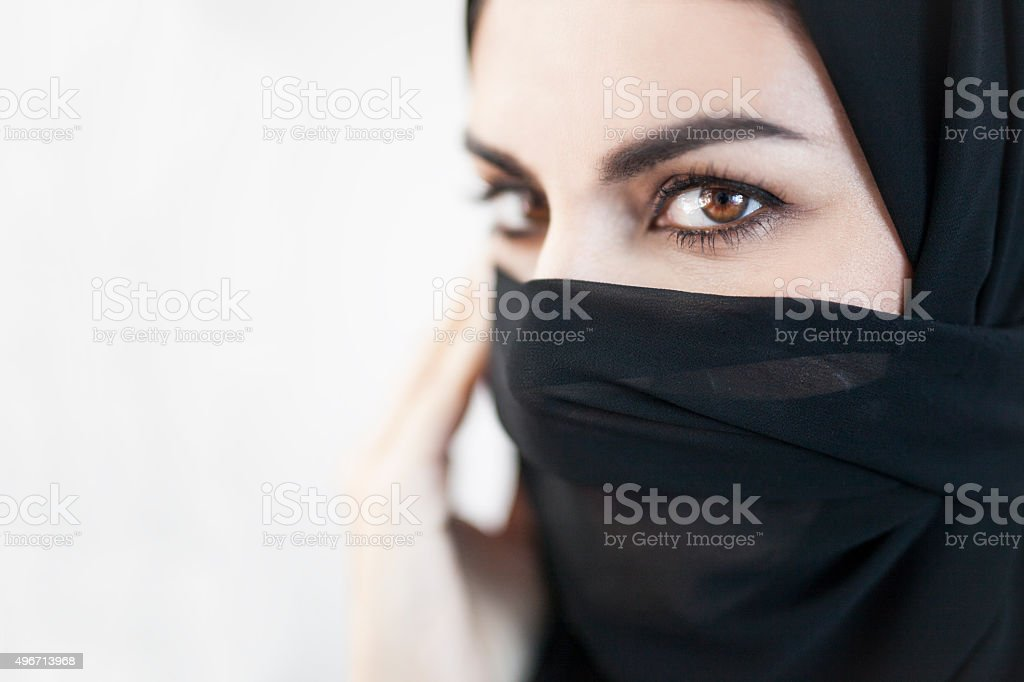 Emirati Woman Gaze with Her Face Covered stock photo