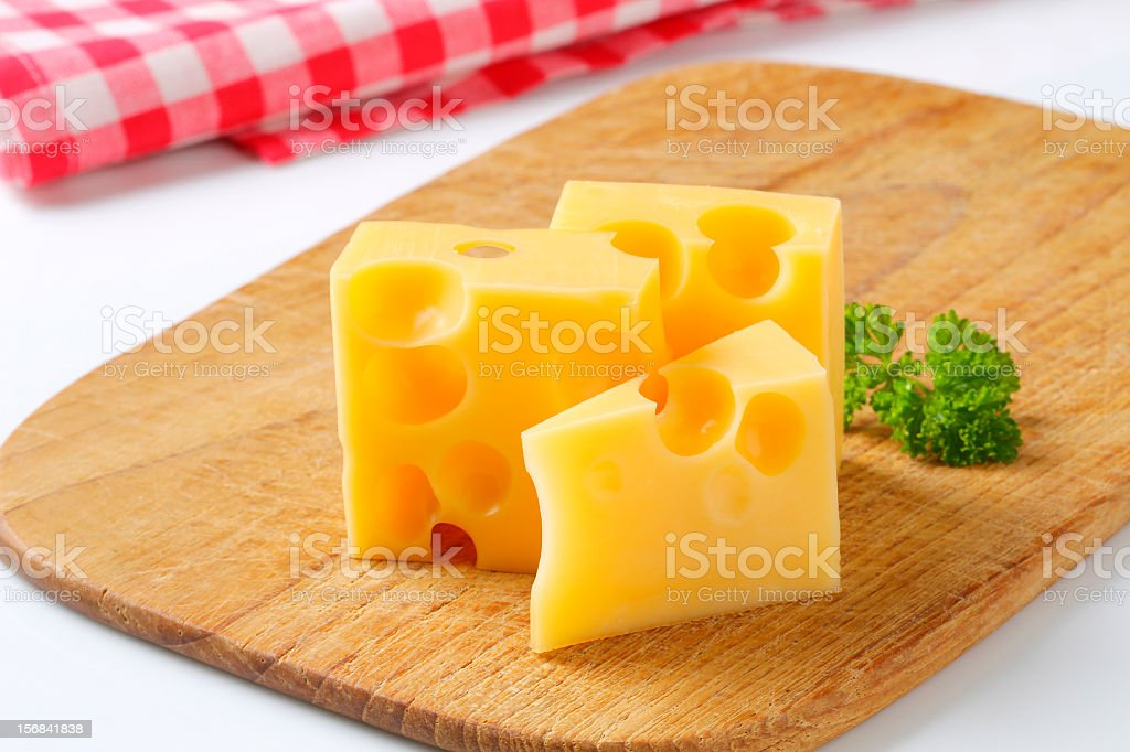 emmental cheese on a cutting board royalty-free stock photo