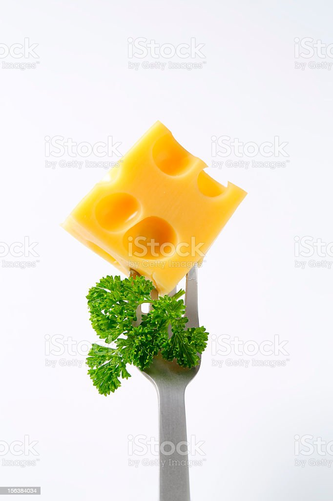 emmental cheese on a fork royalty-free stock photo