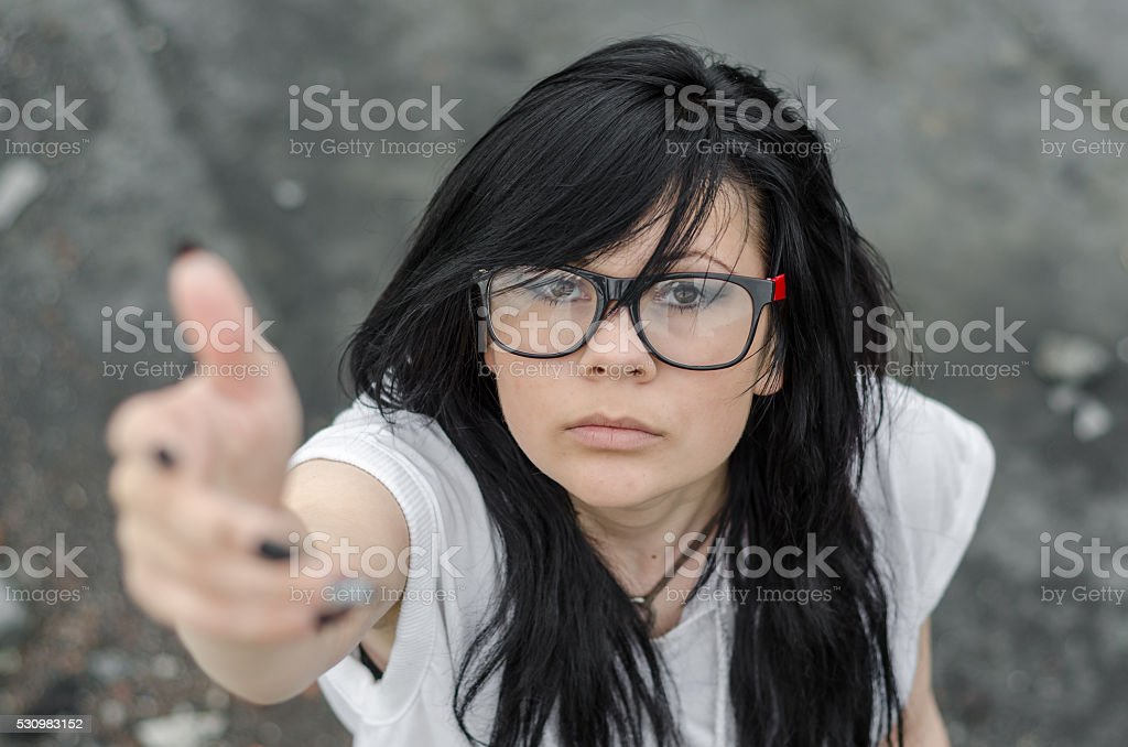 Emo Girl providing or seeking a helping hand or hope stock photo