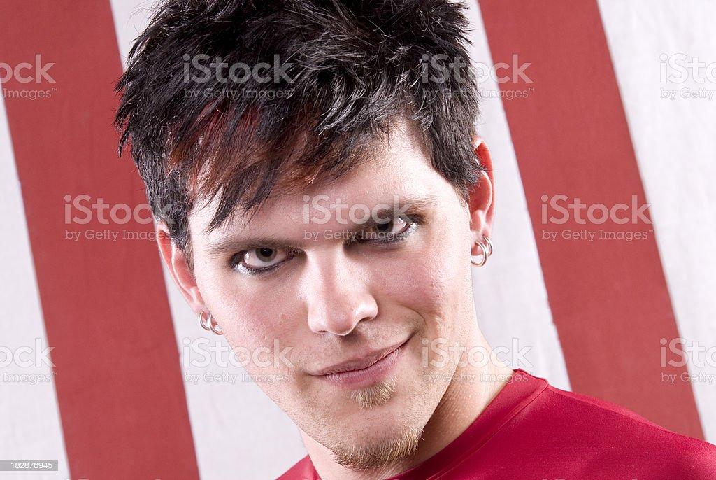Emo Punker, Rebellious Man & Face Eye Makeup Smiliing with Attitude royalty-free stock photo