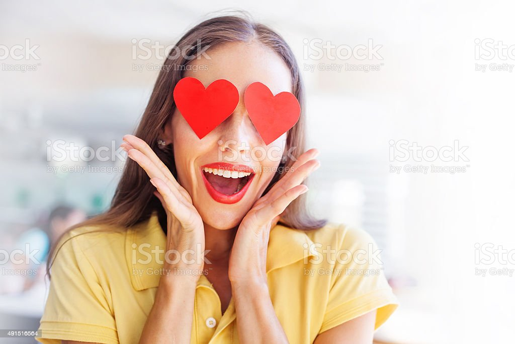emoji concept: woman with the hearts instead of her eyes stock photo