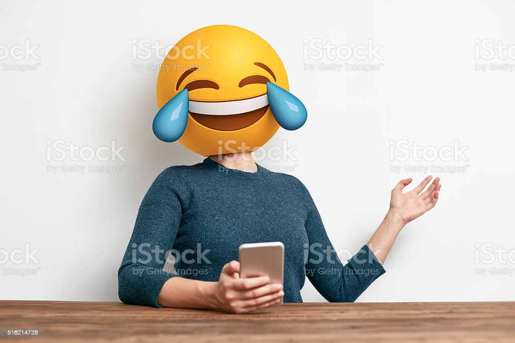 Emoji Head Woman sitting at desk. stock photo