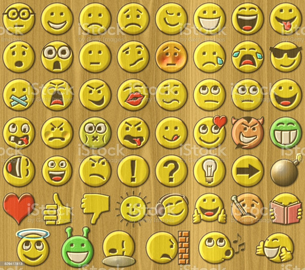 Emoticons relief painting on generated wood texture background stock photo