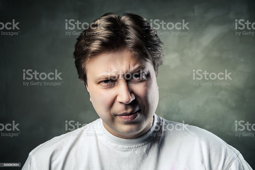 emotional angry middle aged man over gray stock photo