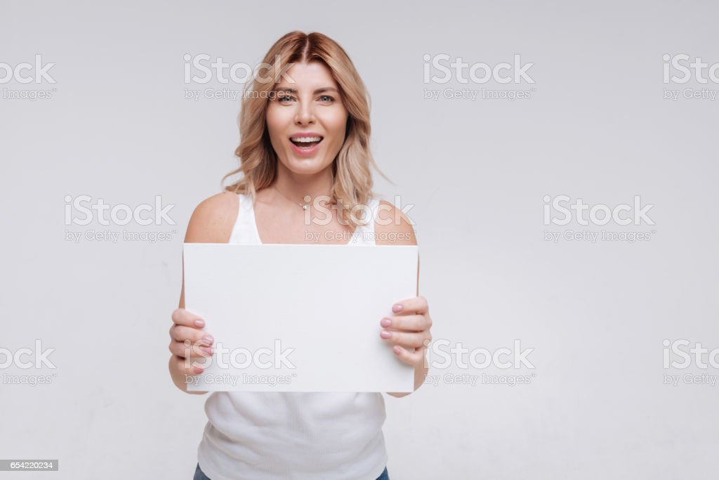 Emotional charismatic young woman looking excited stock photo