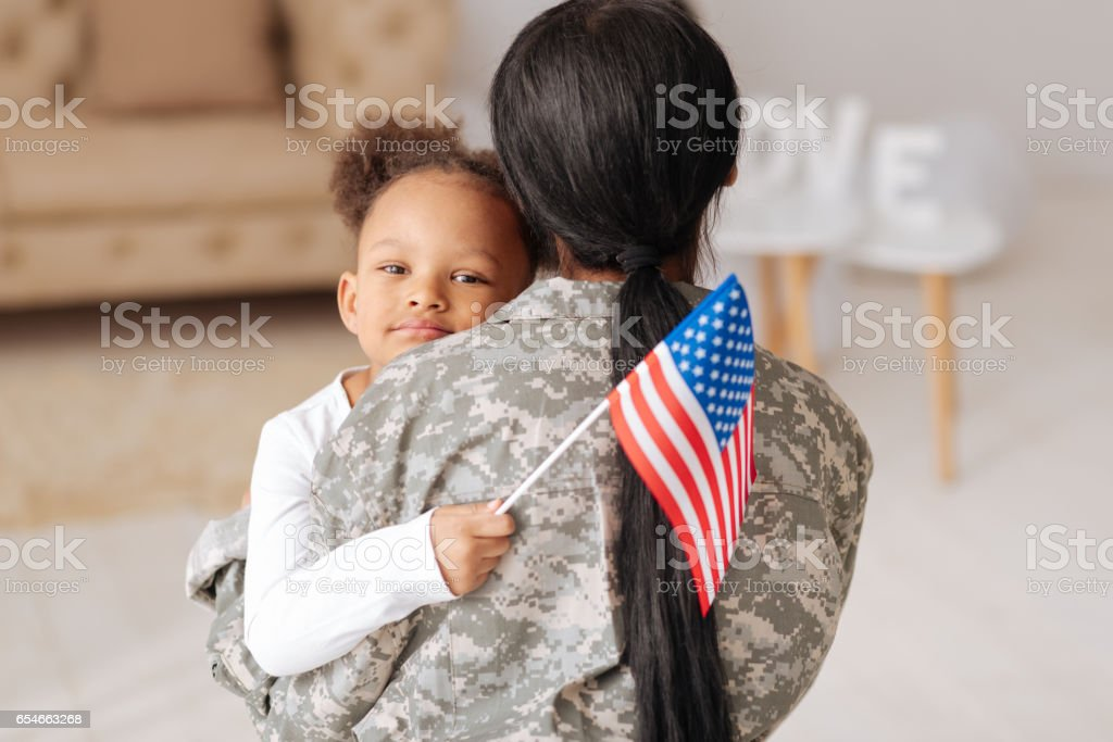 Emotional child really happy seeing her mother stock photo