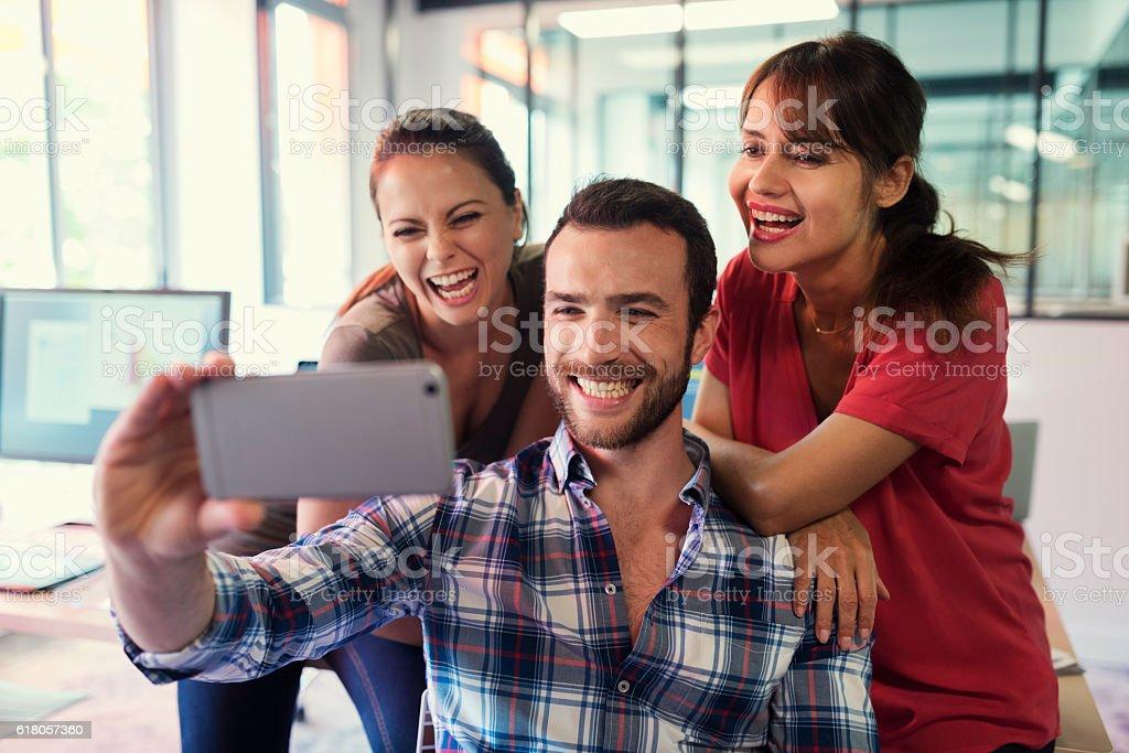 Emotional funy Selfie. Casual creative group taking selfie stock photo
