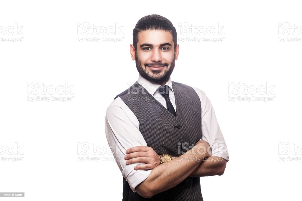 Emotional handsome middle eastern businessman on white background. stock photo