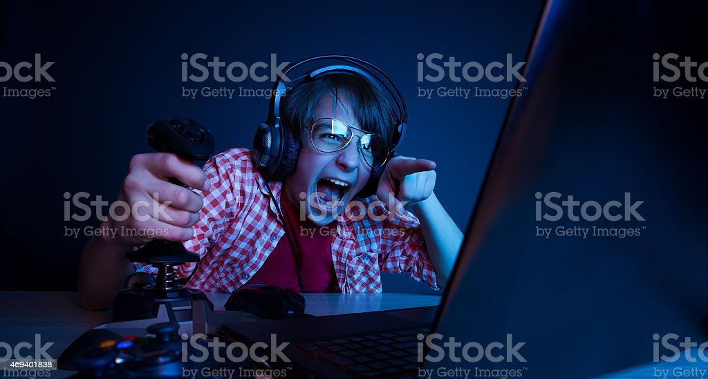 Emotional kid play video game stock photo