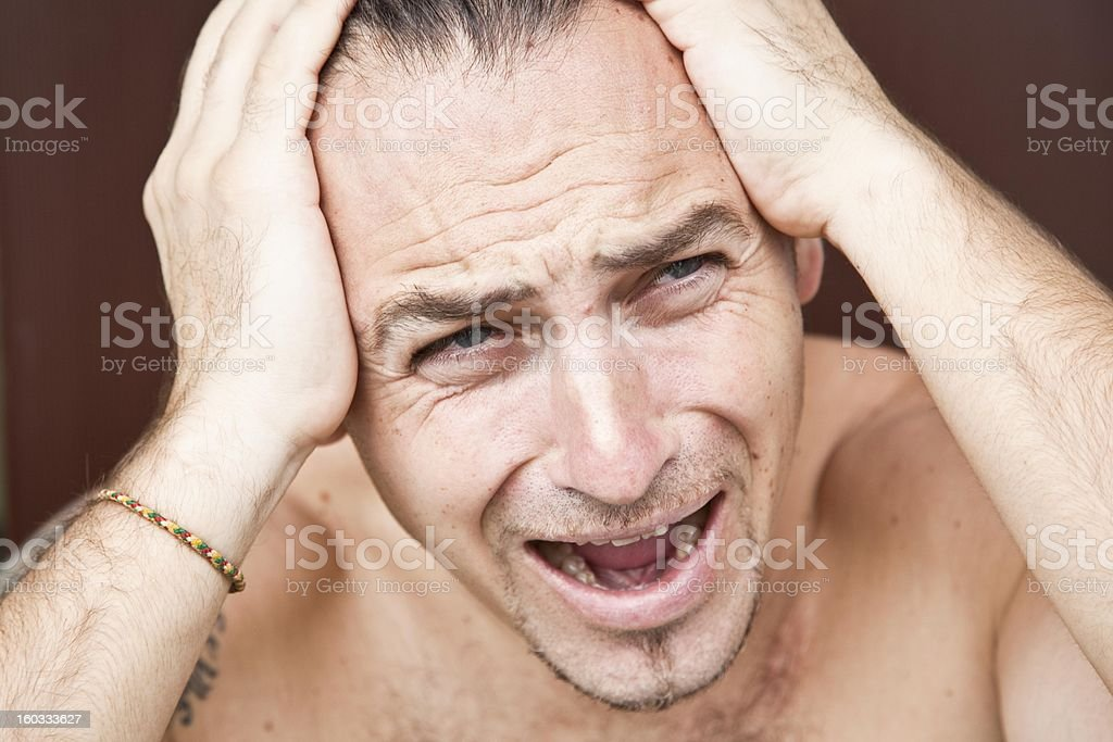 Emotional man with a headache royalty-free stock photo
