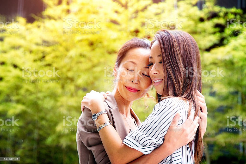 Emotional reunion between Japanese mother and daughter stock photo