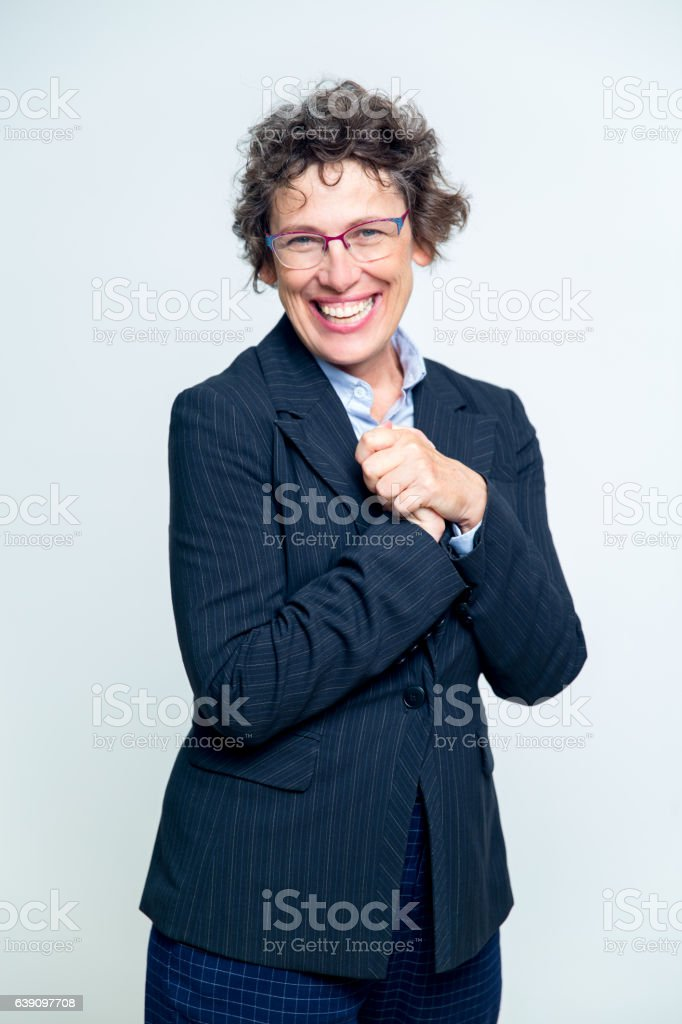 Emotional Senior Woman Clasping Hands on Chest stock photo