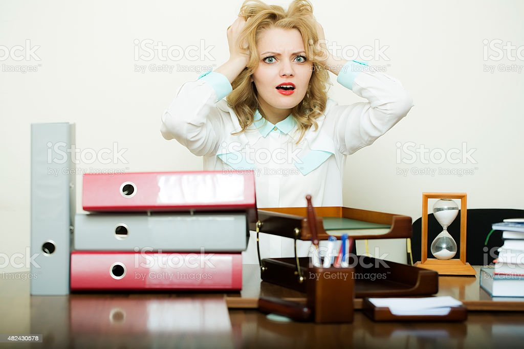 Emotional woman in office stock photo