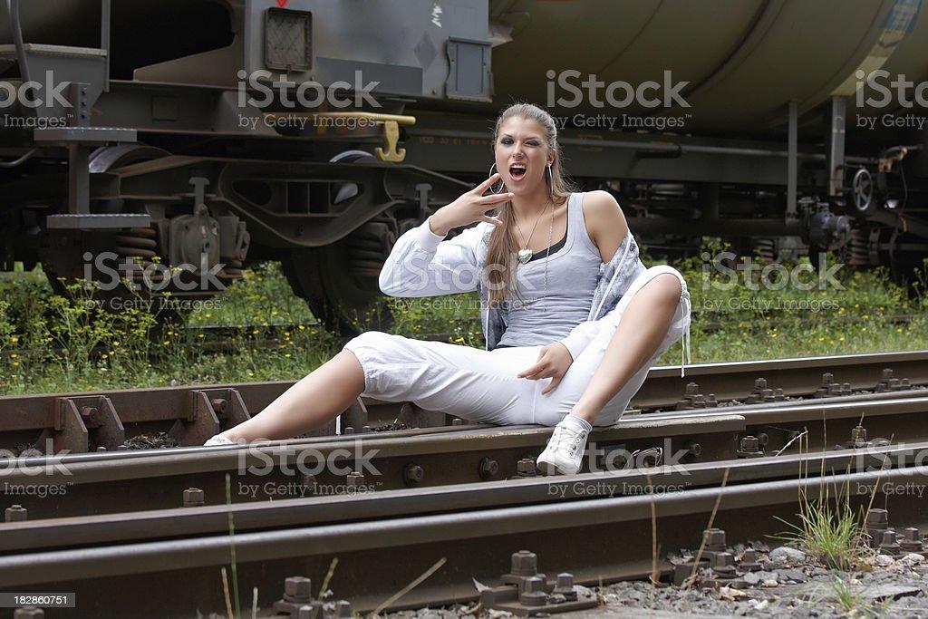 emotional woman on railroad tracks stock photo