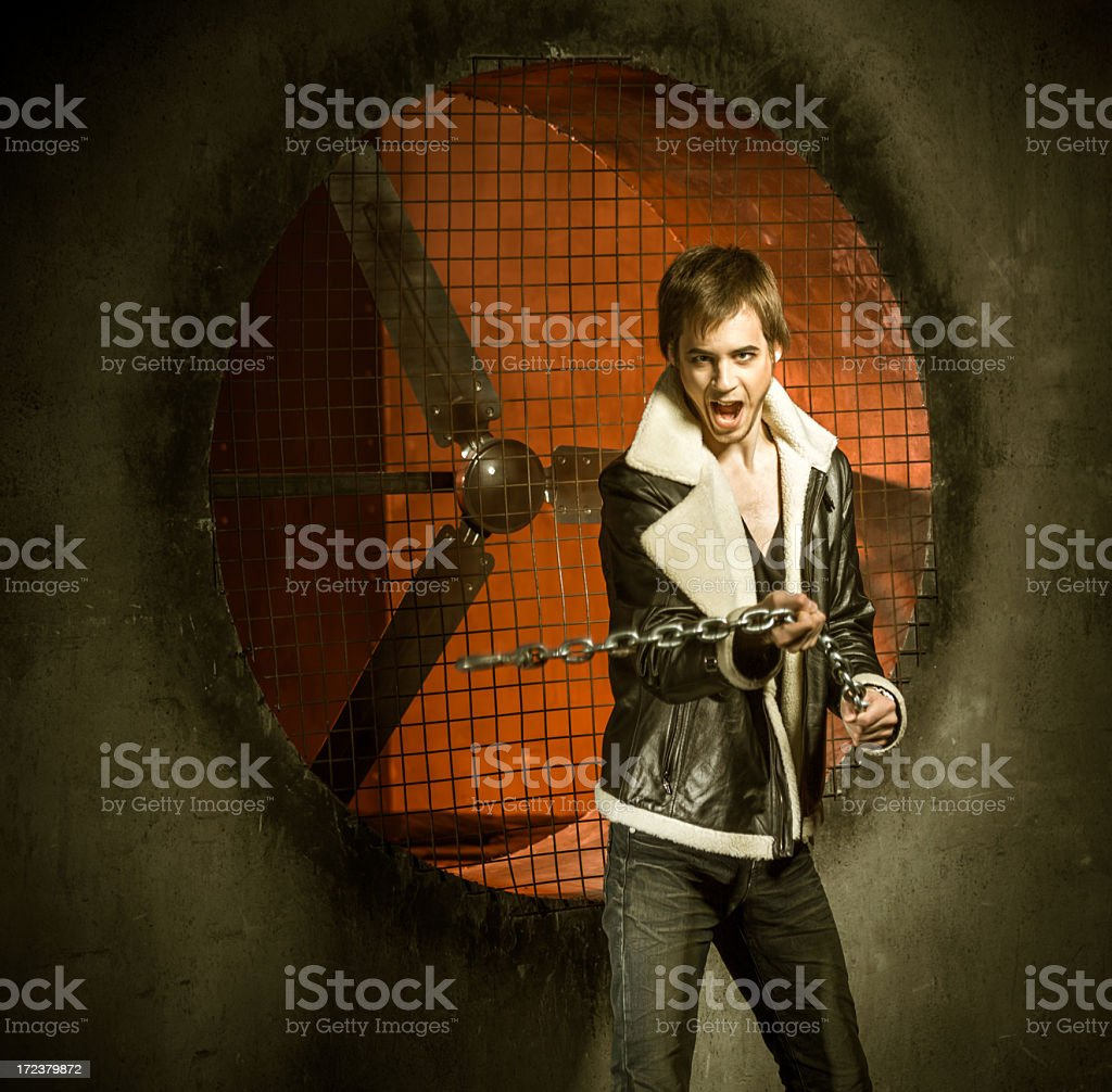 Emotional young man with metal chain royalty-free stock photo