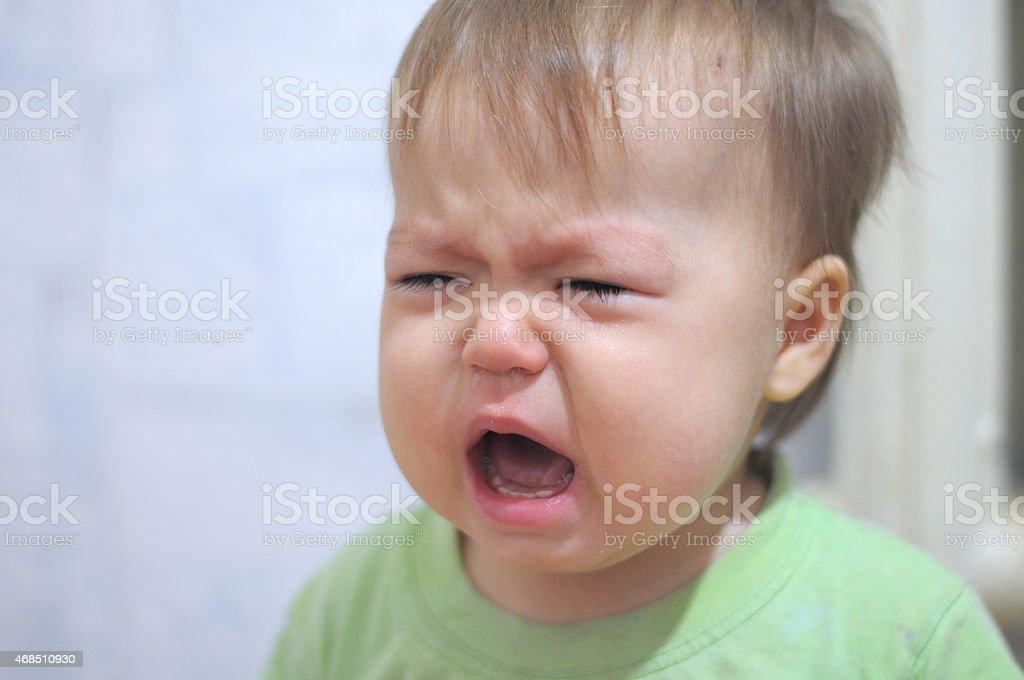 Emotionally crying baby stock photo