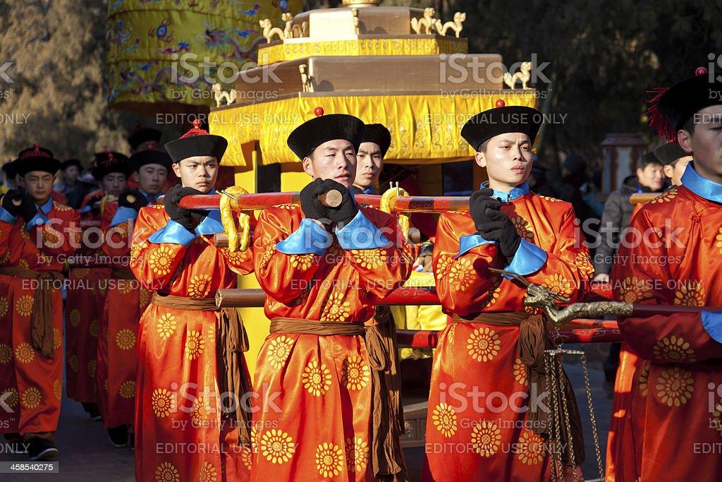 Emperor Guards carry sedan chair stock photo