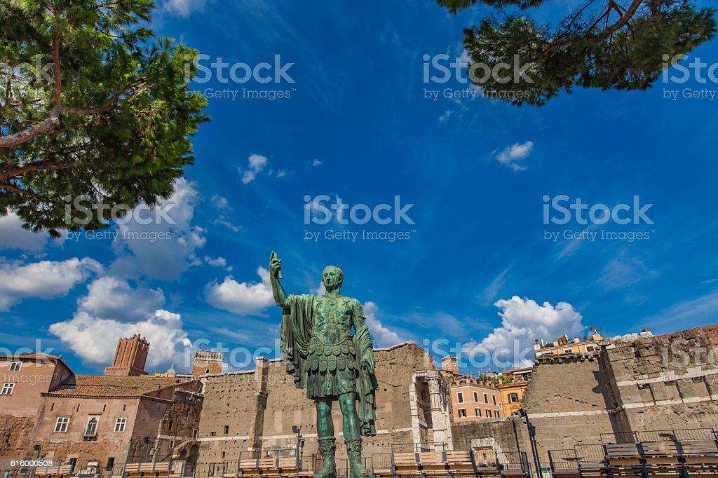 Emperor Julius Caesar Statue in front of Ancient Trajan stock photo