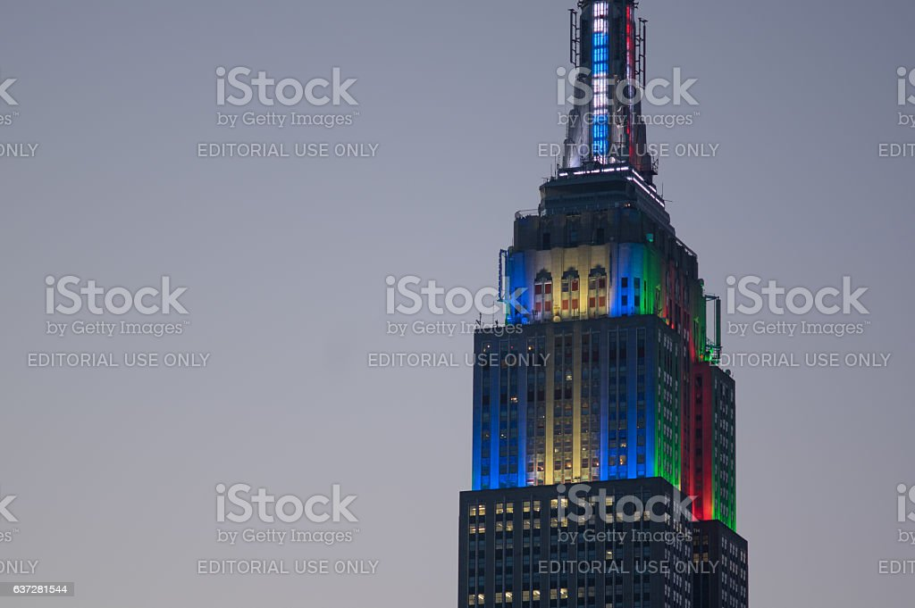 Empire State Building in white-blue Hanukkah and red-green Christmas colors stock photo