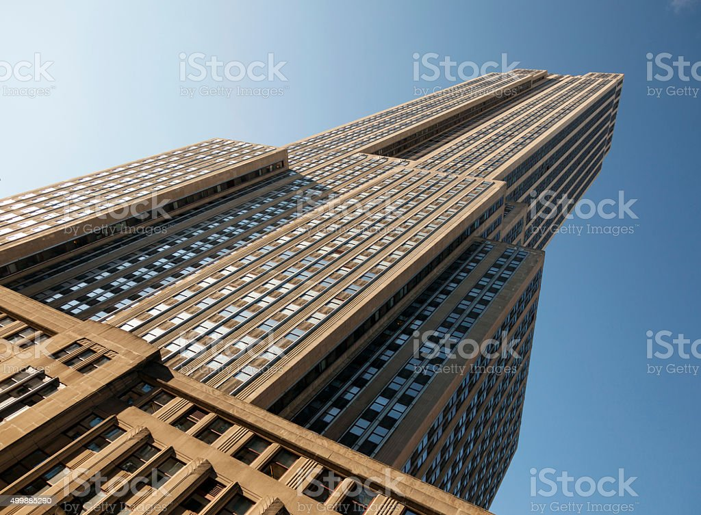 empire state building seen from 34th street and blue sky stock photo