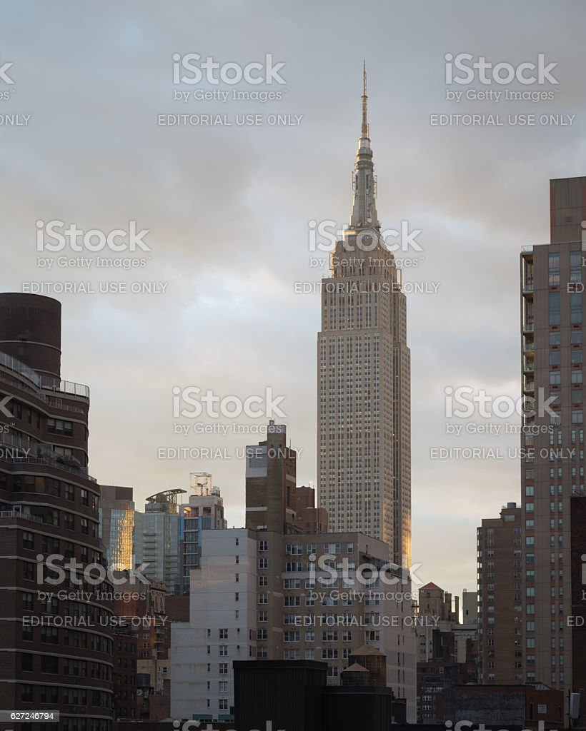 Empire State Building side lit at sunset stock photo