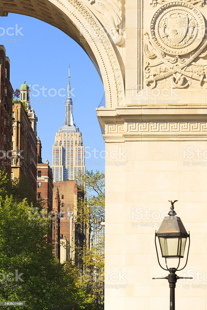 Empire State Building through Washington Arch stock photo
