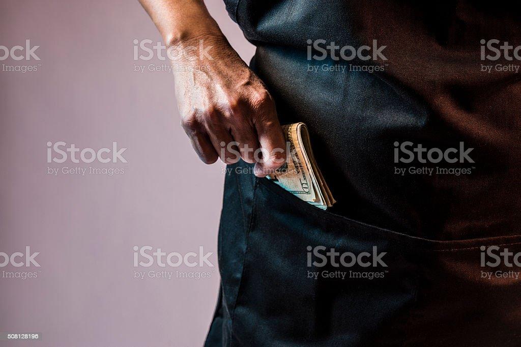 Employee cash theft concept stock photo