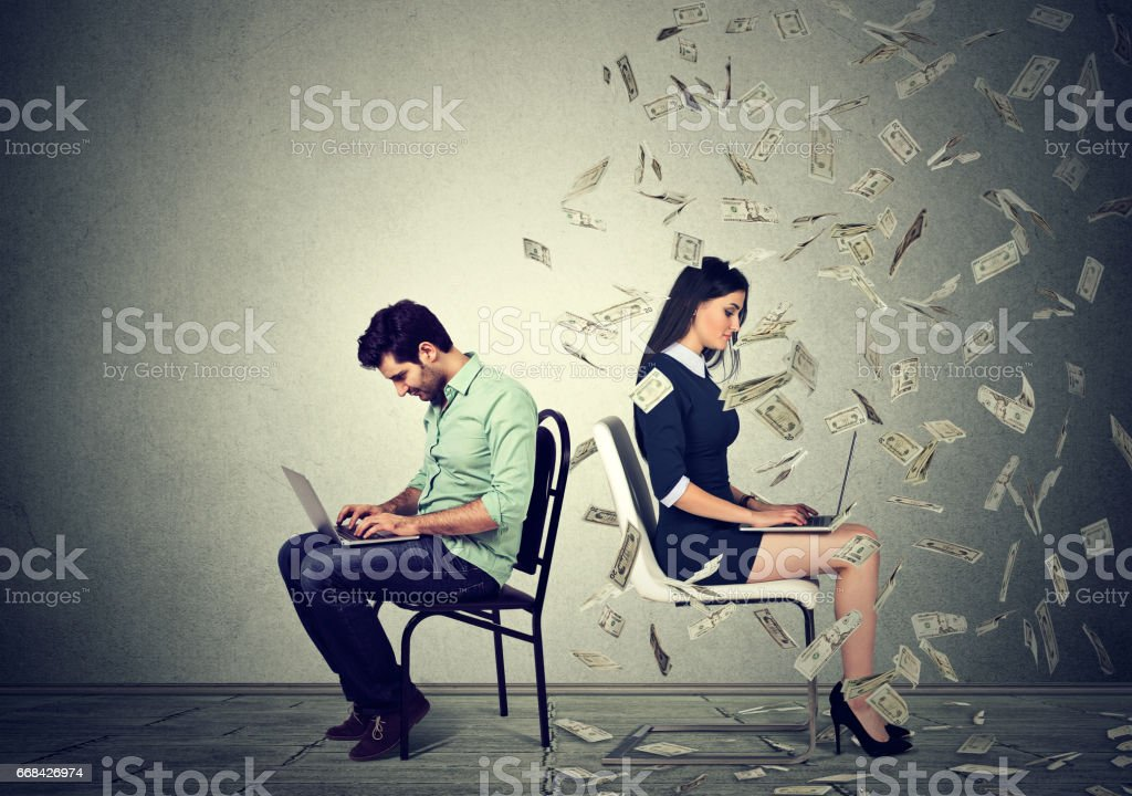 Employee compensation economy. Man working on laptop sitting next to young woman under money rain. Pay difference concept. stock photo