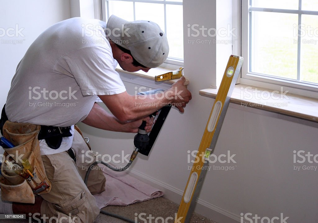 Employee diligently working in summer time on window royalty-free stock photo