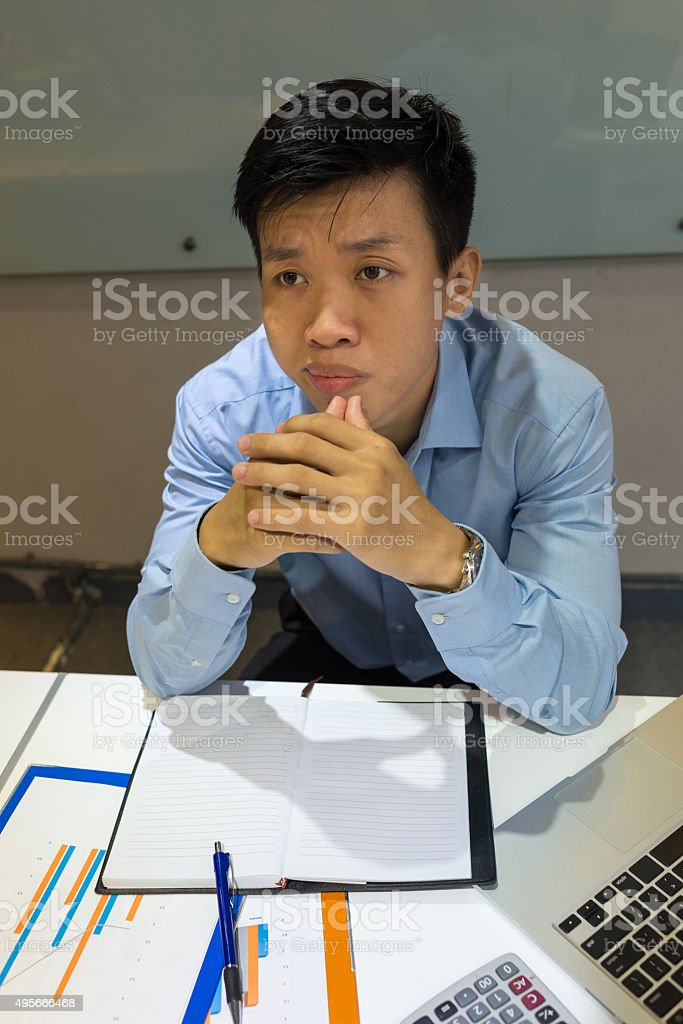 Employee doesn't know how to explain to boss about problem stock photo