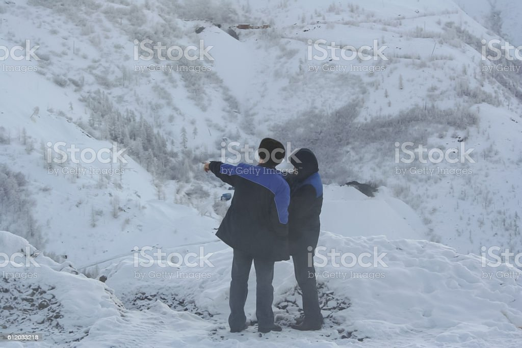 Employee Geological Survey indicates the direction of his colleague stock photo