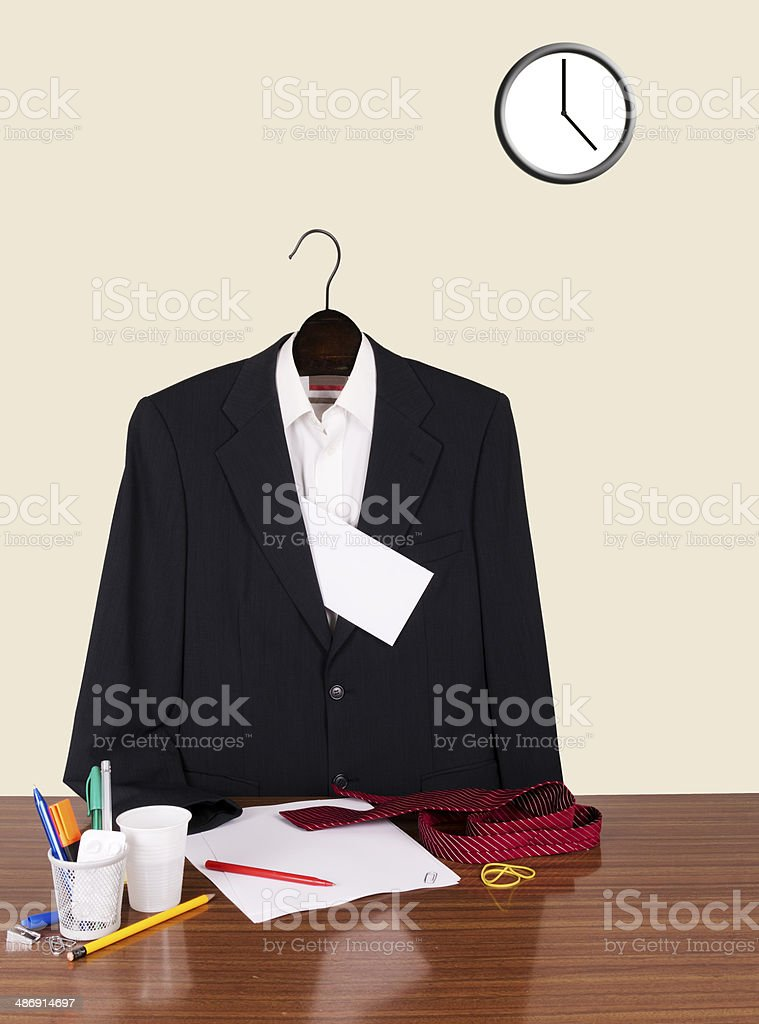 Employee gone home leaving note - suit, letter and clock stock photo