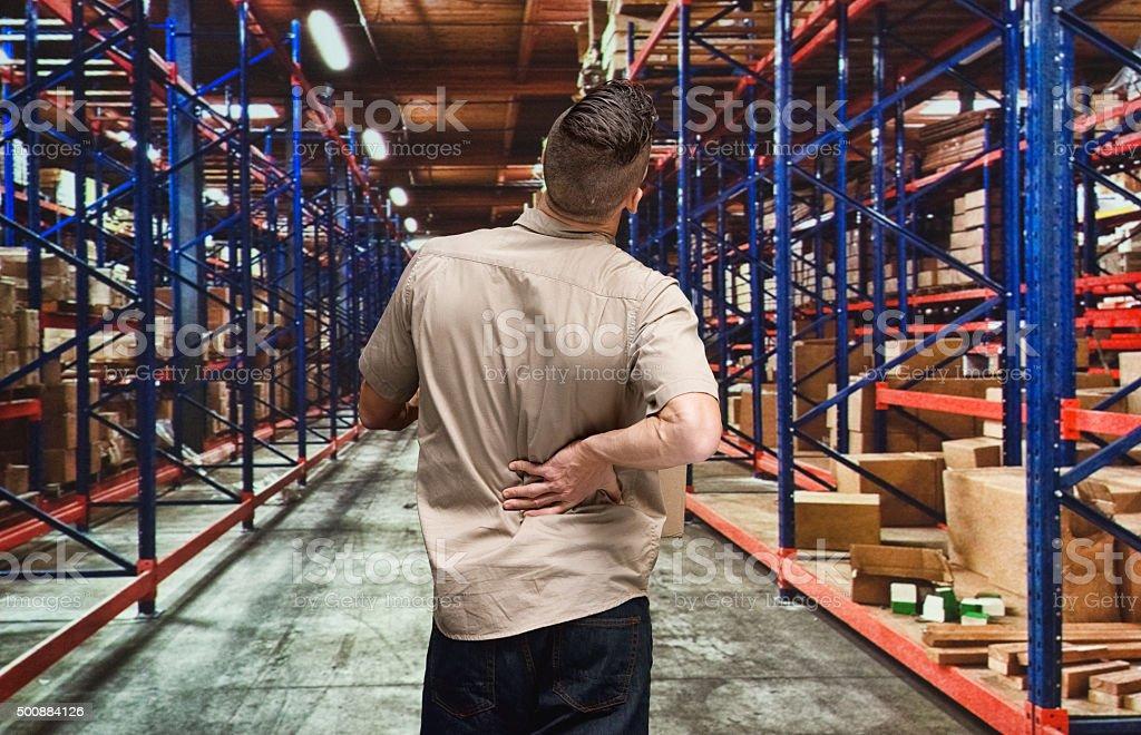 Employee having back pain stock photo