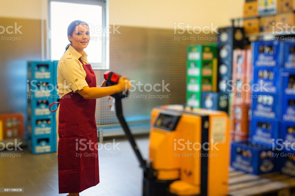 employee in supermarket warehouse stock photo