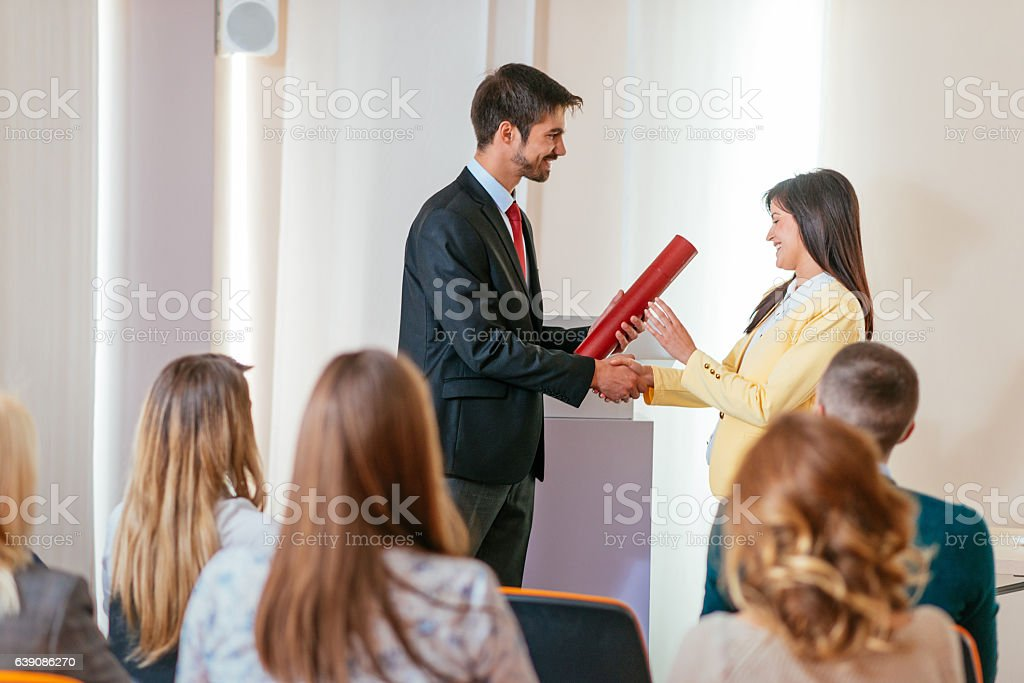 Employee of the month received award on ceremony stock photo